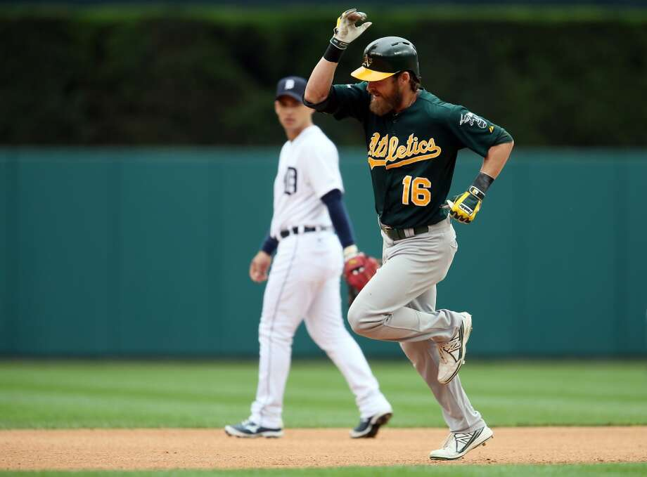 Josh Reddick #16 of the Oakland Athletics celebrates a solo home run in the fourth inning against the Detroit Tigers during Game Three of the American League Division Series at Comerica Park on October 7, 2013 in Detroit, Michigan. Photo: Rob Carr, Getty Images