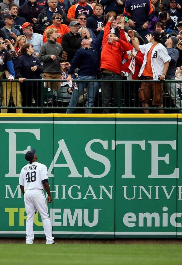 Torii Hunter of the Detroit Tigers watches a home run hit by Josh Reddick of the Oakland Athletics in the fourth inning during Game Three of the American League Division Series at Comerica Park on October 7, 2013 in Detroit, Michigan. Photo: Rob Carr, Getty Images