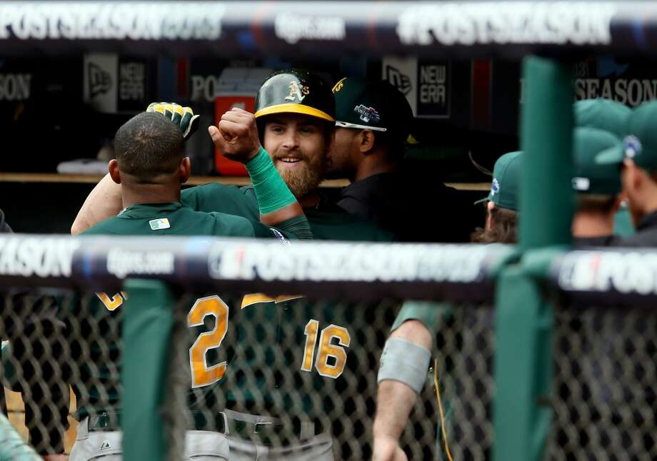 Josh Reddick celebrates a solo home run with Yoenis Cespedes #52 of the Oakland Athletics in the fourth inning against the Detroit Tigers during Game Three of the American League Division Series at Comerica Park on October 7, 2013 in Detroit, Michigan. Photo: Rob Carr, Getty Images