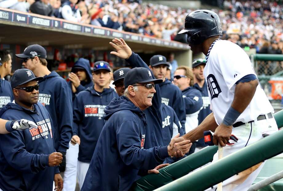 Manager Jim Leyland #10 congratulates Torii Hunter #48 of the Detroit Tigers after scoring a run in the fourth inning against the Oakland Athletics during Game Three of the American League Division Series at Comerica Park on October 7, 2013 in Detroit, Michigan. Photo: Rob Carr, Getty Images
