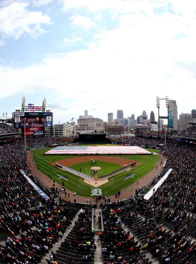 The Detroit Tigers and the Oakland Athletics line up for the national anthem prior to Game Three of the American League Division Series at Comerica Park on October 7, 2013 in Detroit, Michigan. Photo: Leon Halip, Getty Images