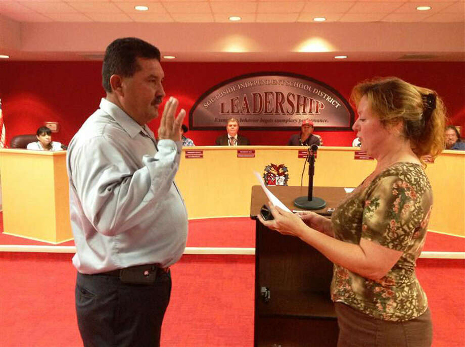 """Notary Public Sheila Staggs, right, swears in John Nolan Wood as a new Southside ISD Board of Trustees member at last week's board's meeting. He was chosen by the board to replace Tony Luna, who resigned for """"personal reasons"""" after less than five months in office. Photo: Courtesy"""
