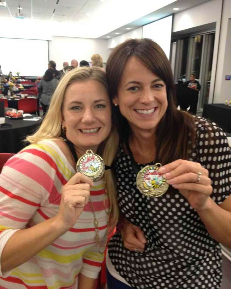 Amanda Castro, a kindergarten teacher at Schiff Elementary School, left, and Dani Herrera, Parent-Teacher Association president at Schiff Elementary, show off their third-place spelling bee medals. Photo: Photo By Fort Bend Independent School District