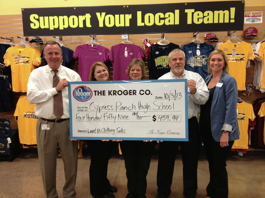 Representatives of Kroger Co. present Cy Ranch principal Bob Hull, far left, with a check for $459.94 from sales of school apparel. Photo: Provided By Cy Ranch High School