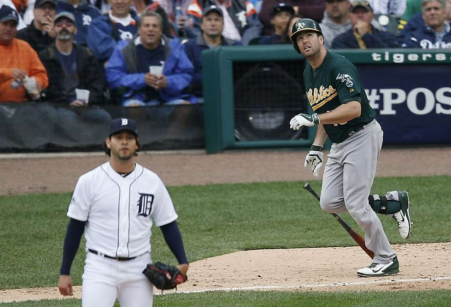 A's designated hitter Seth Smith and Tigers starter Anibal Sanchez watch Smith's two-run homer in the fifth inning. The blast chased Sanchez, the American League ERA leader, from the game and gave the A's a 6-3 lead. Photo: Charles Rex Arbogast, Associated Press