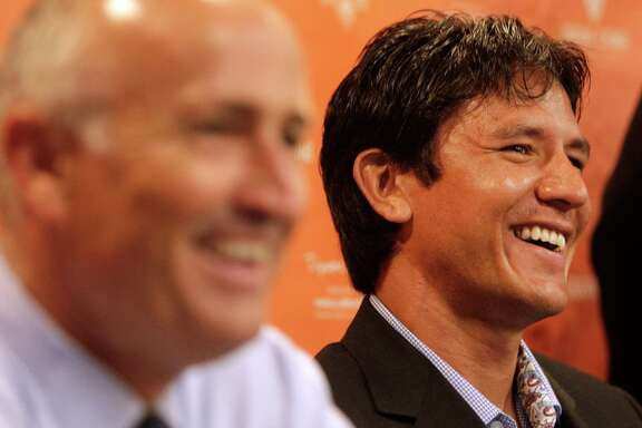 Houston Dynamo coach Dominic Kinnear, left, and player Brian Ching, right, share a laugh as they talk during a media conference about Ching's retirement at BBVA Compass Stadium Tuesday, Sept. 24, 2013, in Houston. The Houston Dynamo and Dynamo Charities will host a Brian Ching Testimonial Match on Dec. 13. The event will benefit, The House That Ching Built, which is Ching's  partnership with Houston Habitat for Humanity. ( Melissa Phillip / Houston Chronicle )