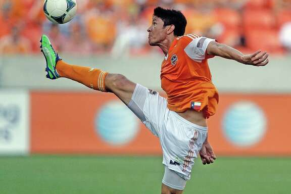 HOUSTON, TX - APRIL 14: Brian Ching #25 of the Houston Dynamo controls a high ball during the second half against the Chicago Fire at BBVA Compass Stadium on April 14, 2013 in Houston, Texas. Houston's 2-1 win was their 35th in a row at home and a MLS record. (Photo by Bob Levey/Getty Images)