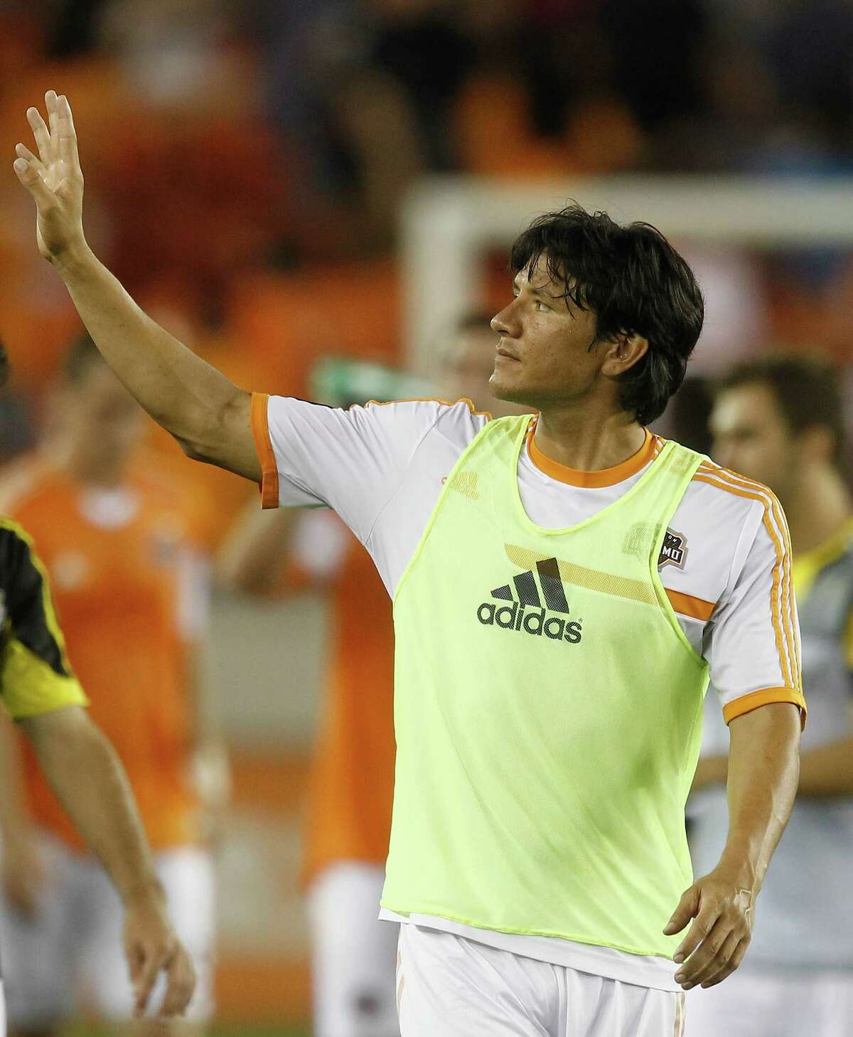 HOUSTON, TX - AUGUST 03: Brian Ching #25 of Houston Dynamo waves to the crowd after a win against the Columbus Crew 3-1 at BBVA Compass Stadium on August 3, 2013 in Houston, Texas. (Photo by Bob Levey/Getty Images)