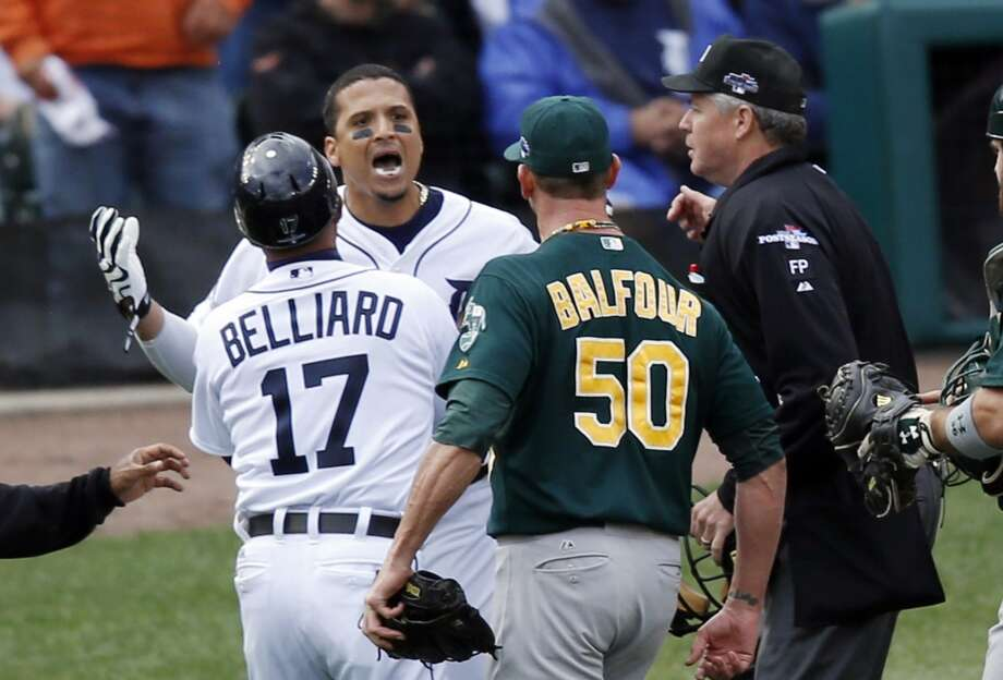 Detroit Tigers first base coach Rafael Belliard (17) and home plate umpire Gary Darling, right, step between Detroit Tigers designated hitter Victor Martinez, second from left, and Oakland Athletics relief pitcher Grant Balfour during the ninth inning of Game 3 of an American League baseball division series in Detroit, Monday, Oct. 7, 2013. Photo: Charles Rex Arbogast, Associated Press