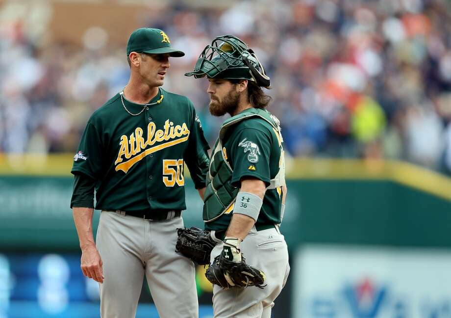 Grant Balfour speaks with Derek Norris in the ninth inning during Game Three. Photo: Rob Carr, Getty Images