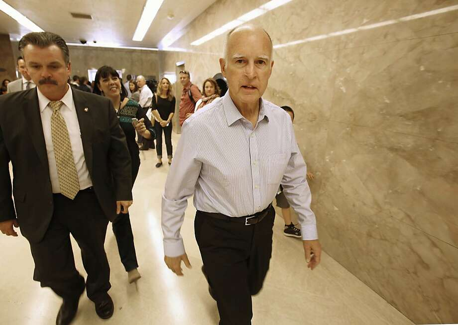 Gov. Jerry Brown walk through the Capitol in Sacramento, Calif., Friday, Oct. 4, 2013.  Brown will become California's longest serving governor when he surpasses Earl Warren's 10-year tenure in the office on Monday.  Warren served as governor from Jan. 4, 1943 to Oct. 5, 1953, when he resigned to join the U.S. Supreme Court.  Brown, who is now 75, first took office at age 36 in 1975, serving two four-year terms.  The Democrat was able to run for the office again because his first stint as governor came before California's term limits law, which restricts governors to two terms. (AP Photo/Rich Pedroncelli) Photo: Rich Pedroncelli, Associated Press