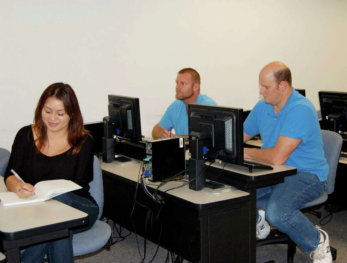 Lone Star College Kingwood AutoCAD students Rosa Saucedo, Ryan Vallee and Garth Faries work on an assignment.