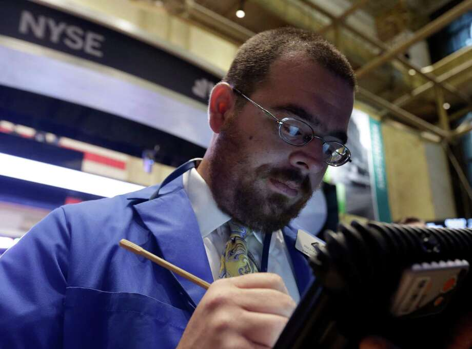 FILE - In this Wednesday, Oct. 2, 2013, file photo, trader Richard Scardino works on the floor of the New York Stock Exchange. Stock futures are falling sharply, Monday, Oct. 7, 2013, as the U.S. government heads into the second week of a partial shutdown with no signs of a budget agreement in sight. (AP Photo/Richard Drew, File) ORG XMIT: NYBZ101 Photo: Richard Drew / AP