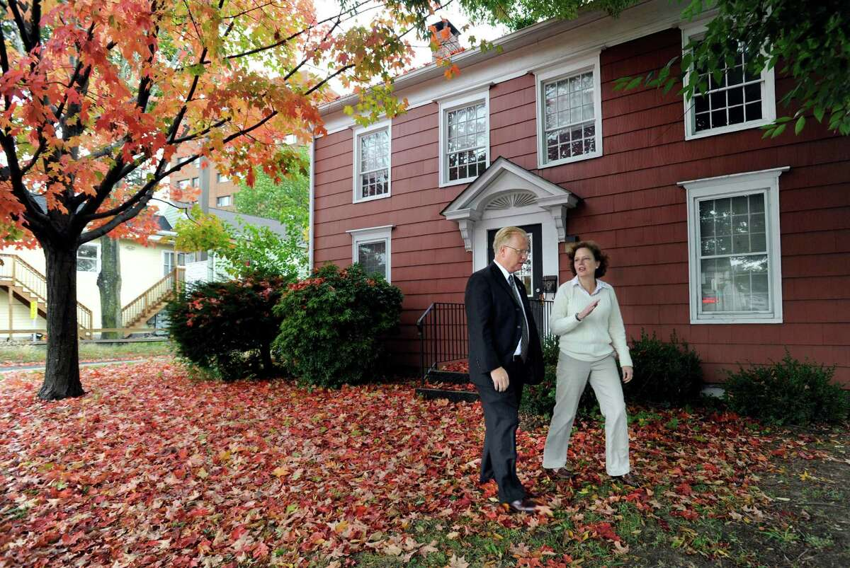 Danbury Mayor Mark Boughton and Caroline LaFleur, director of DanburyâÄôs Promise for Children Partnership, speak together in front of the former McLean House on Main Street, Monday, Oct. 7, 2013. The partnership, in collaboration with the city, is collaborating on an Office of Early Childhood that will be located in the home.