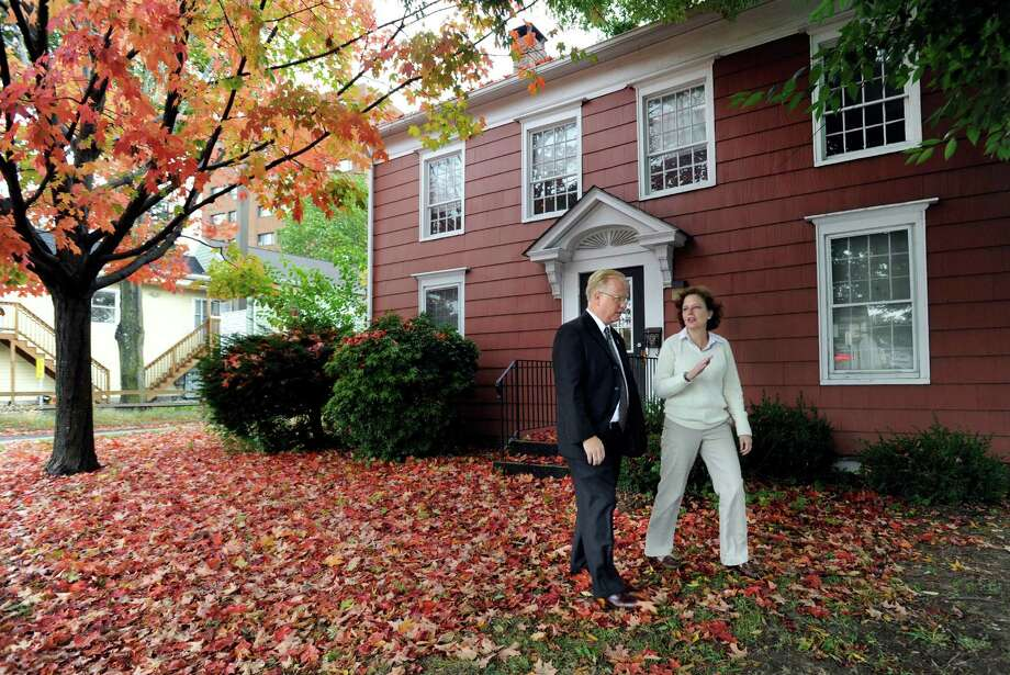 Danbury Mayor Mark Boughton and Caroline LaFleur, director of DanburyâÄôs Promise for Children Partnership, speak together in front of the former McLean House on Main Street, Monday, Oct. 7, 2013. The partnership, in collaboration with the city, is collaborating on an Office of Early Childhood that will be located in the home. Photo: Carol Kaliff / The News-Times