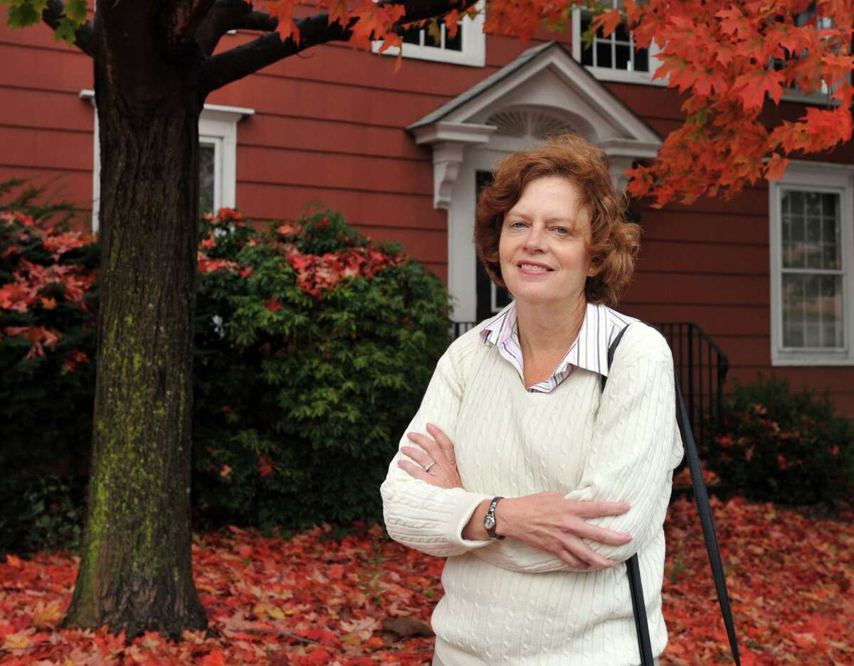 Caroline LaFleur, director of DanburyâÄôs Promise for Children Partnership, is photographed in front of the former McLean House on Main Street, Monday, Oct. 7, 2013. The partnership, in collaboration with the city, is collaborating on an Office of Early Childhood that will be located in the home.