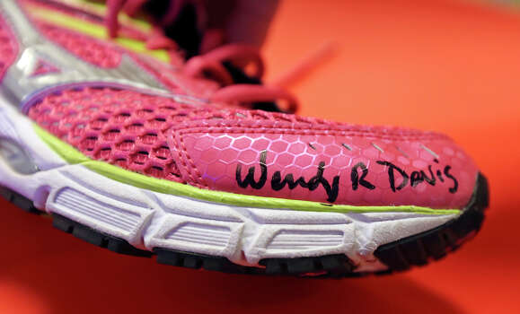 Detail of State Senator Wendy Davis, who is running for Texas Governor, autograph on a shoe for Jeremy Wasner's  wife Michelle Wasner (not pictured) during a tour of Rackspace Hosting Inc. Monday Oct. 7, 2013. Photo: Edward A. Ornelas, San Antonio Express-News / © 2012 San Antonio Express-News