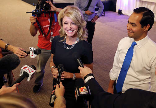 State Senator Wendy Davis, who is running for Texas Governor, (left) and Mayor Julian Castro answer questions from the media during a tour Rackspace Hosting Inc.  Monday Oct. 7, 2013. Photo: Edward A. Ornelas, San Antonio Express-News / © 2012 San Antonio Express-News