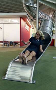 State Senator Wendy Davis, who is running for Texas Governor, takes the slide on a tour of Rackspace Hosting Inc. Monday Oct. 7, 2013. Photo: Edward A. Ornelas, San Antonio Express-News / © 2012 San Antonio Express-News
