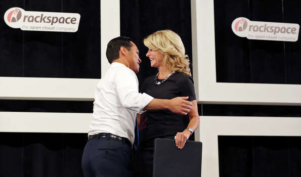 Mayor Julian Castro (left) and state Senator Wendy Davis, who is running for Texas Governor, hug while speaking during a tour of Rackspace Hosting Inc. Monday Oct. 7, 2013. Photo: Edward A. Ornelas, San Antonio Express-News / © 2012 San Antonio Express-News