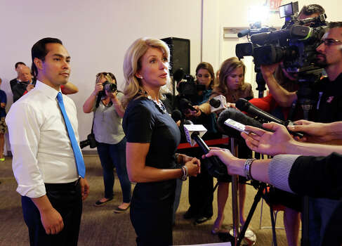 Mayor Julian Castro (left) and state Senator Wendy Davis, who is running for Texas Governor, answer questions from the media during a tour of Rackspace Hosting Inc. Monday Oct. 7, 2013. Photo: Edward A. Ornelas, San Antonio Express-News / © 2012 San Antonio Express-News