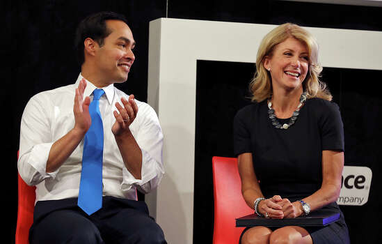 Mayor Julian Castro (left) and state Senator Wendy Davis, who is running for Texas Governor, listen to speakers on a tour of Rackspace Hosting Inc. Monday Oct. 7, 2013. Photo: Edward A. Ornelas, San Antonio Express-News / © 2012 San Antonio Express-News