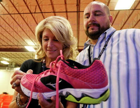 State Senator Wendy Davis, who is running for Texas Governor, autographs a shoe for Jeremy Wasner's (right) wife Michelle Wasner (not pictured) during a tour of Rackspace Hosting Inc. Monday Oct. 7, 2013. Photo: Edward A. Ornelas, San Antonio Express-News / © 2012 San Antonio Express-News