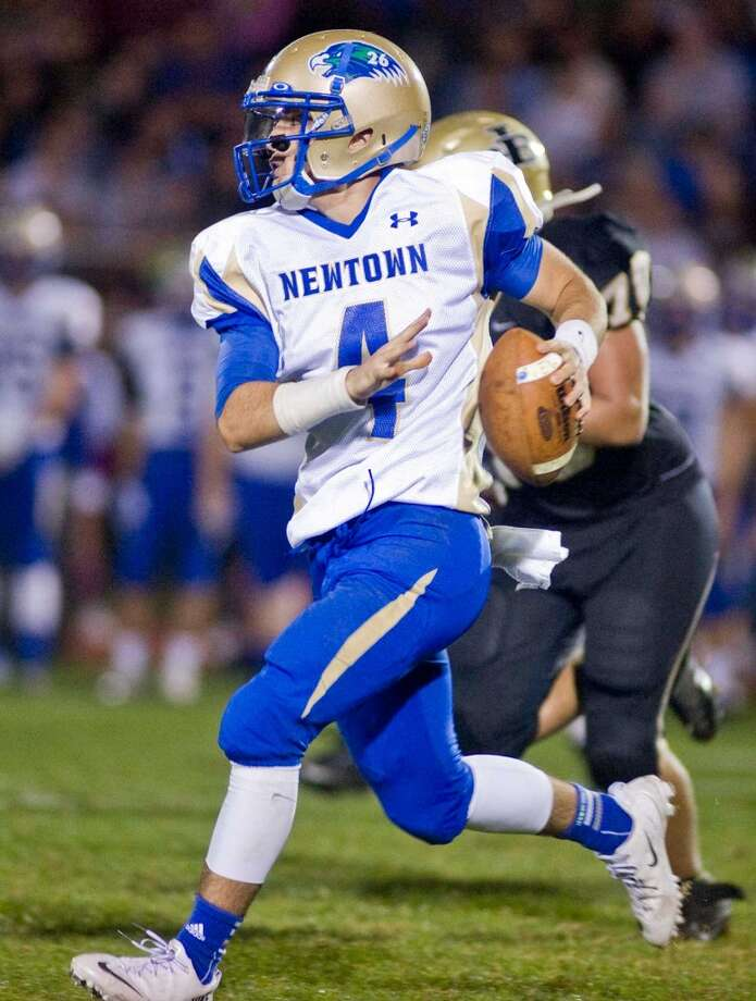 Newtown High School quarterback Andrew Tarantino looks for a receiver during a game against Joel Barlow, played at Joel Barlow High School. Friday, Oct. 4, 2013 Photo: Scott Mullin