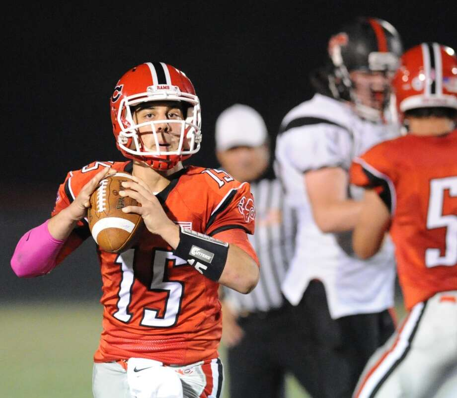 New Canaan quarterback Nick Cascione (# 15) during the second quarter of the high School football game between New Canaan High School and Fairfield Warde High School at New Canaan, Friday night, Oct. 4, 2013. Photo: Bob Luckey