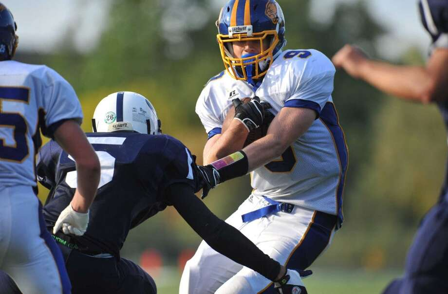 Brookfield's Robert Drysdale (9) runs against at Immaculate at Immaculate High School in Danbury, Conn. on Saturday, Oct. 5, 2013. Photo: Tyler Sizemore