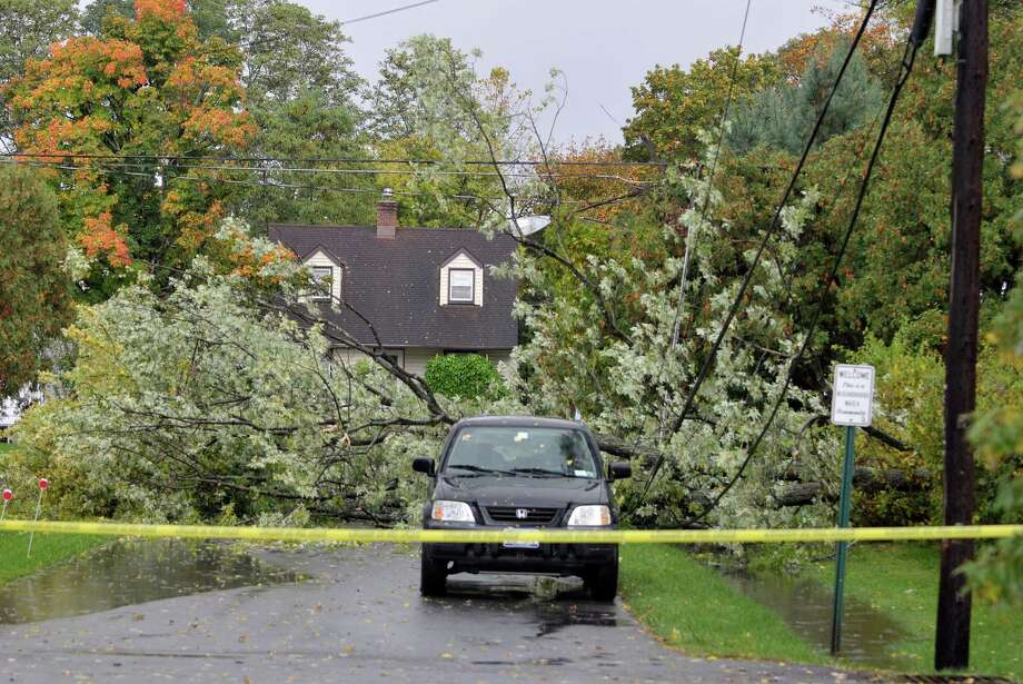 A section of Winslow St. and Crannell Ave. in Delmar was closed after a section of a tree fell over some electrical lines Monday afternoon, Oct. 7, 2013, after storm rolled through the Capital Region.  (Paul Buckowski / Times Union) Photo: Paul Buckowski / 00024153A