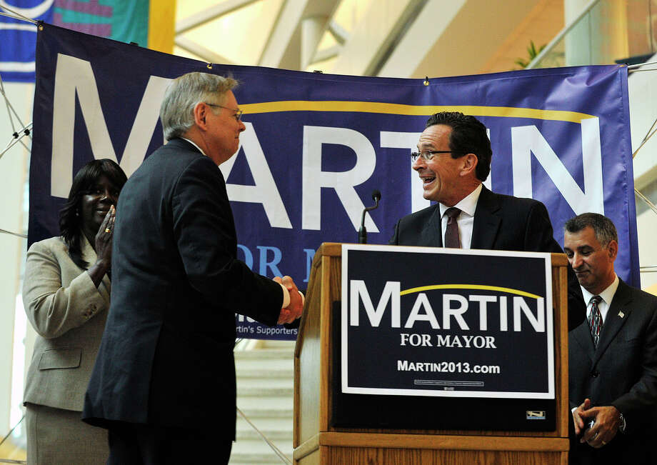 Gov. Dannel P. Malloy, right, introduces Stamford Democratic mayoral candidate David Martin after formally endorsing him at the University of Connecticut's Stamford campus on Monday, Oct. 7, 2013. Photo: Jason Rearick / Stamford Advocate