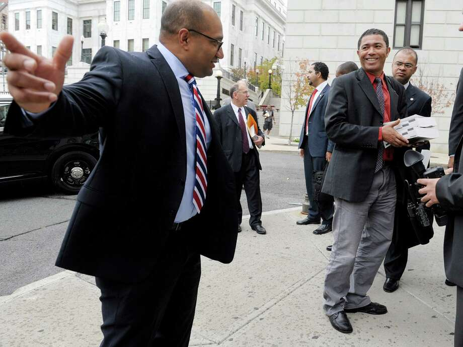 Albany County District Attorney David Soares, left, talks with Judge Manuel Spencer,  center, and Judge Bernardino Delgado, right, outside the Albany County Judicial Center on Monday, Oct, 7, 2013.  Six members of a delegation from the justice ministry of the Republic of Cape Verde were visiting with the D.A. and members of his staff on Monday.  The Republic of Cape Verde is the home country of Soares.  Cape Verde is an island off the coast of Western Africa.  The delegation consisted of judges, defense attorneys and prosecutors.   (Paul Buckowski / Times Union) Photo: Paul Buckowski / 00024152A