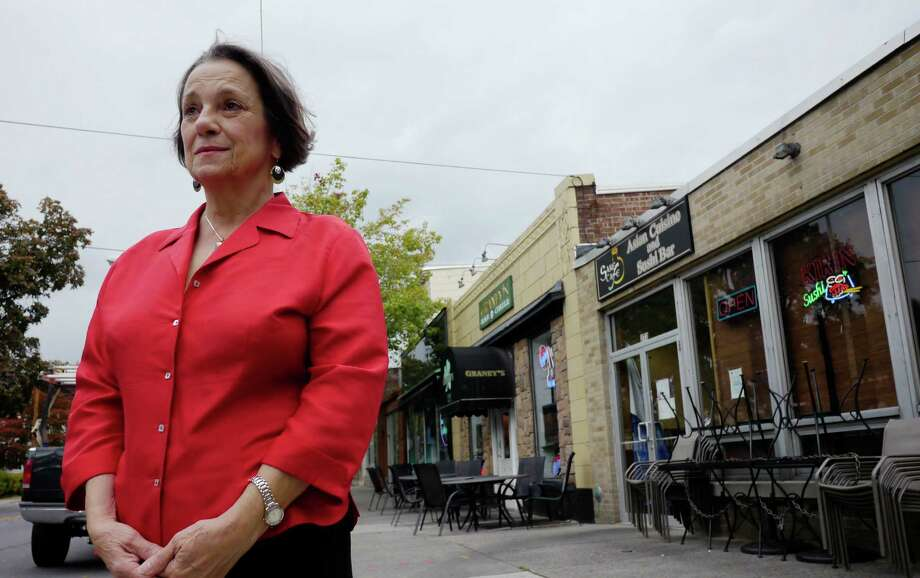 Local resident Dee Burkins stands in the 200 block area of New Scotland Avenue on Monday, Oct. 7, 2013, in Albany, N.Y.   There are plans in the works for a new bar called the  Beer Belly to open at 281 New Scotland, the current location of Shutter Speed Photo.  Burkins along with some other residents hope to stop it, saying that there are already too many bars on this section of New Scotland.     (Paul Buckowski / Times Union) Photo: Paul Buckowski / 00024151A