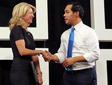 State Senator Wendy Davis, who is running for Texas Governor, (left) and Mayor Julian Castro talk after speaking during a tour of Rackspace Hosting Inc. Monday Oct. 7, 2013. Photo: Edward A. Ornelas, San Antonio Express-News / © 2012 San Antonio Express-News