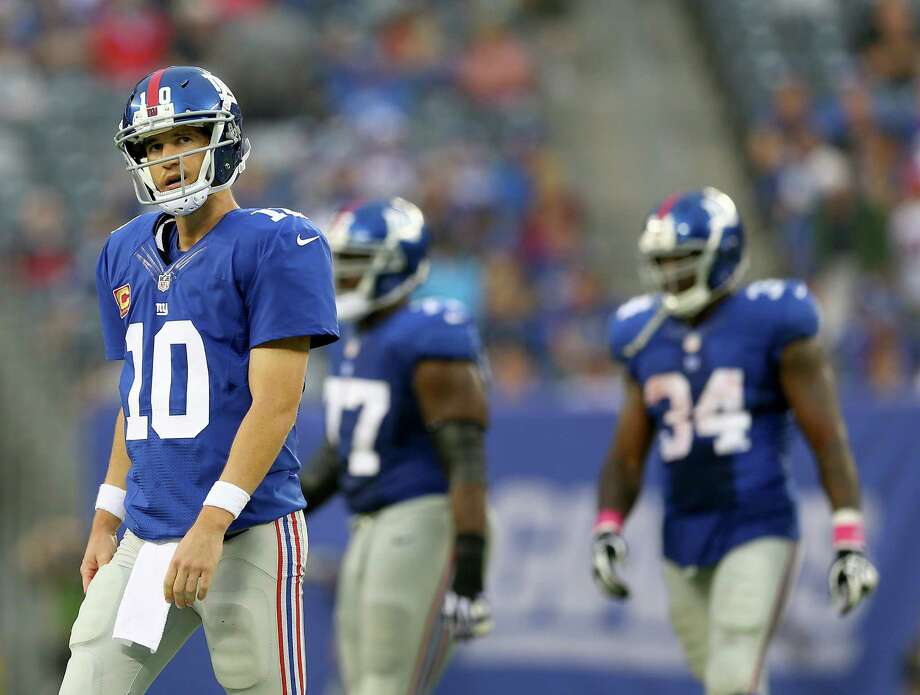 EAST RUTHERFORD, NJ - OCTOBER 06:  Eli Manning #10 of the New York Giants walks off the field after throwing an interception in the fourth quarter against the Philadelphia Eagles at MetLife Stadium on October 6, 2013 in East Rutherford, New Jersey.The Philadelphia Eagles defeated the New York Giants 36-21.  (Photo by Elsa/Getty Images) ORG XMIT: 175889719 Photo: Elsa / 2013 Getty Images