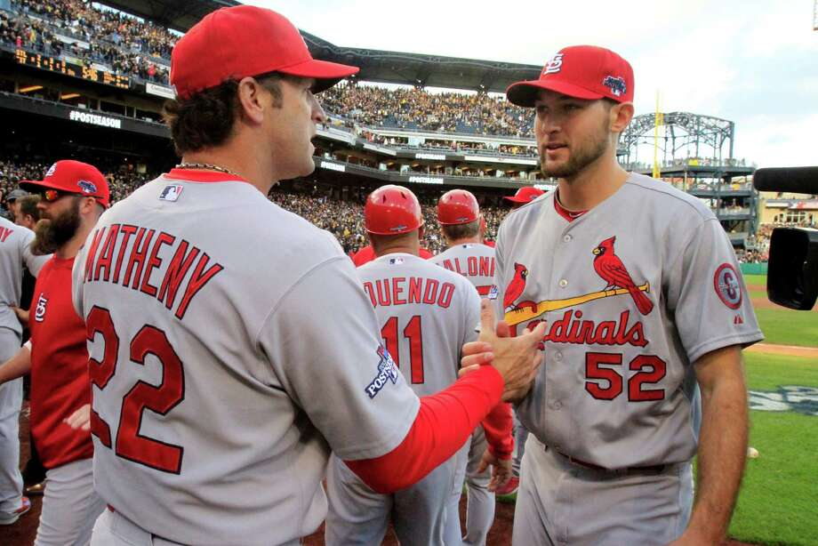 St. Louis Cardinals pitcher Michael Wacha (52) is congratulated by manager Mike Matheny after the Cardinals' 2-1 win over the Pittsburgh Pirates in Game 4 of a National League baseball diviision series, Monday, Oct. 7, 2013 in  Pittsburgh. (AP Photo/Gene J. Puskar) ORG XMIT: PAGP109 Photo: Gene J. Puskar / AP