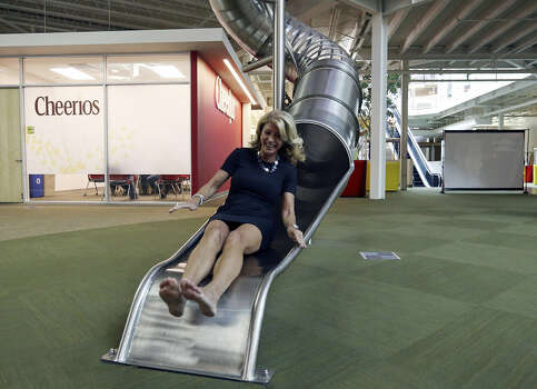 A shoeless Wendy Davis rides down a two-story tube slide at Rackspace Hosting Inc. during her campaign appearance. Photo: Edward A. Ornelas, San Antonio Express-News