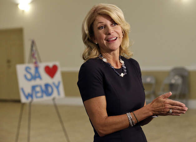 Wendy Davis, answering questions from the media, mobilized volunteers at the San Antonio Firefighters Banquet Hall. Photo: Edward A. Ornelas / San Antonio Express-News