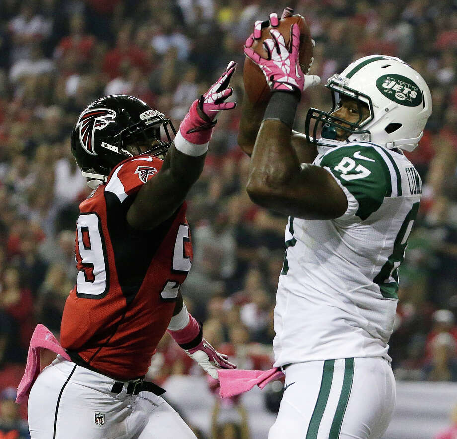 New York Jets tight end Jeff Cumberland (87) catches the ball for a touchdown against Atlanta Falcons outside linebacker Joplo Bartu (59) during the first half of an NFL football game, Monday, Oct. 7, 2013, in Atlanta. (AP Photo/David Goldman) ORG XMIT: GAMS111 Photo: David Goldman / AP