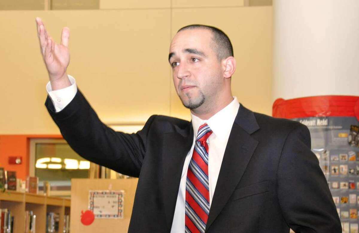 A.J. Albano thanks his supporters after being named as Head Coach for the Brien McMahon High School football team in Norwalk. Albano graduated from McMahon in 2001.