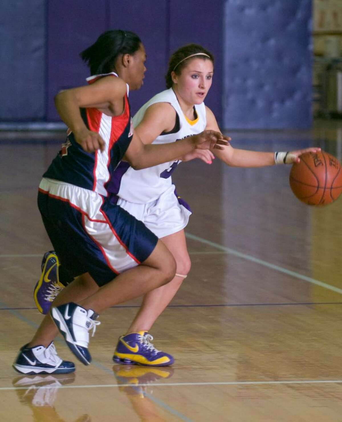 Westhill's Allyson Souza, right, tries to get around Brien McMahon's Khea Gibbs, left, during an FCIAC girls basketball game at Westhill High School in Stamford, Conn. on Tuesday, Jan. 26, 2010