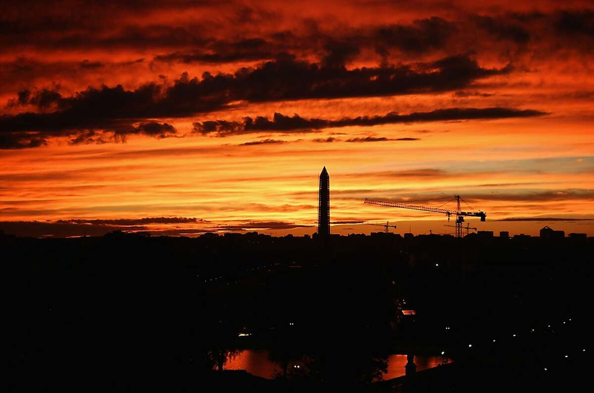 WASHINGTON, DC - OCTOBER 07: A bright orange sky is seen after sunset as the Washington Monument stands October 7, 2013 in Washington, DC. The U.S. Government is on its seventh day of a shutdown. (Photo by Alex Wong/Getty Images)
