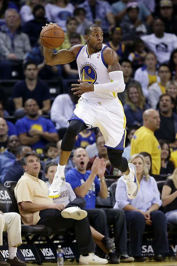 Golden State Warriors' Andre Iguodala saves the ball from going out of bounds against the Sacramento Kings during the second half of an NBA preseason basketball game on Monday, Oct. 7, 2013, in Oakland, Calif. (AP Photo/Marcio Jose Sanchez) Photo: Marcio Jose Sanchez, Associated Press