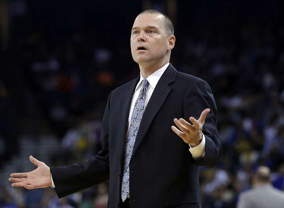 Sacramento Kings cooach Michael Malone questions a call as his team plays the Golden State Warriors during the first half of an NBA preseason basketball game on Monday, Oct. 7, 2013, in Oakland, Calif. (AP Photo/Marcio Jose Sanchez) Photo: Marcio Jose Sanchez, Associated Press