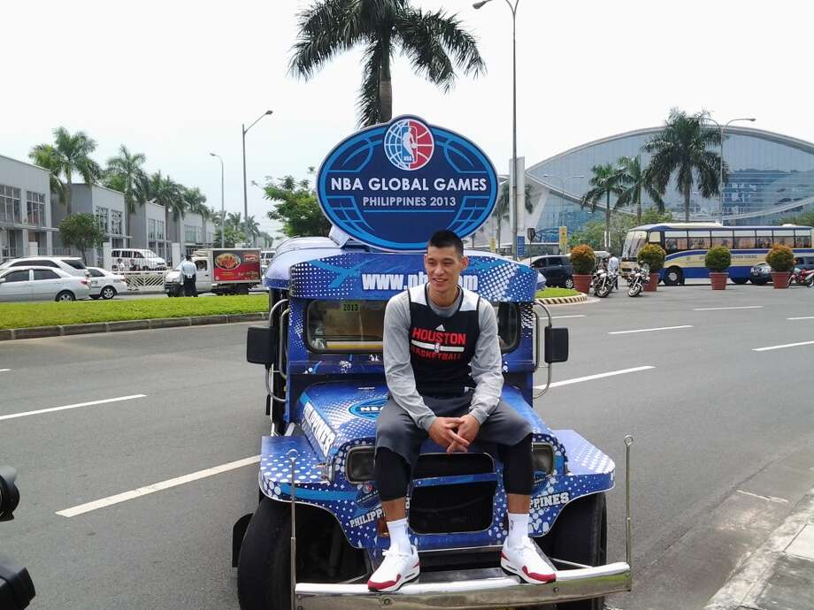 Jeremy Lin poses near the Mall of Asia in the Philippines. Photo: Jonathan Feigen, Houston Chronicle