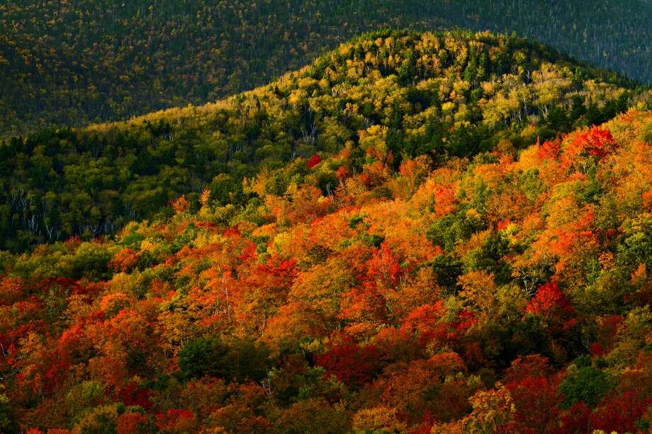 FALL | Adirondack Park's High Peaks region, New York The spectacular fall foliage of upstate New York peaks in September and October. The Adirondack Mountains are an ideal and well known spot to view the shock of autumn colors, attracting thousands of visitors a year.  (From National Geographic's 'Four Seasons of Travel') Photo: Michael Melford, National Geographic Stock