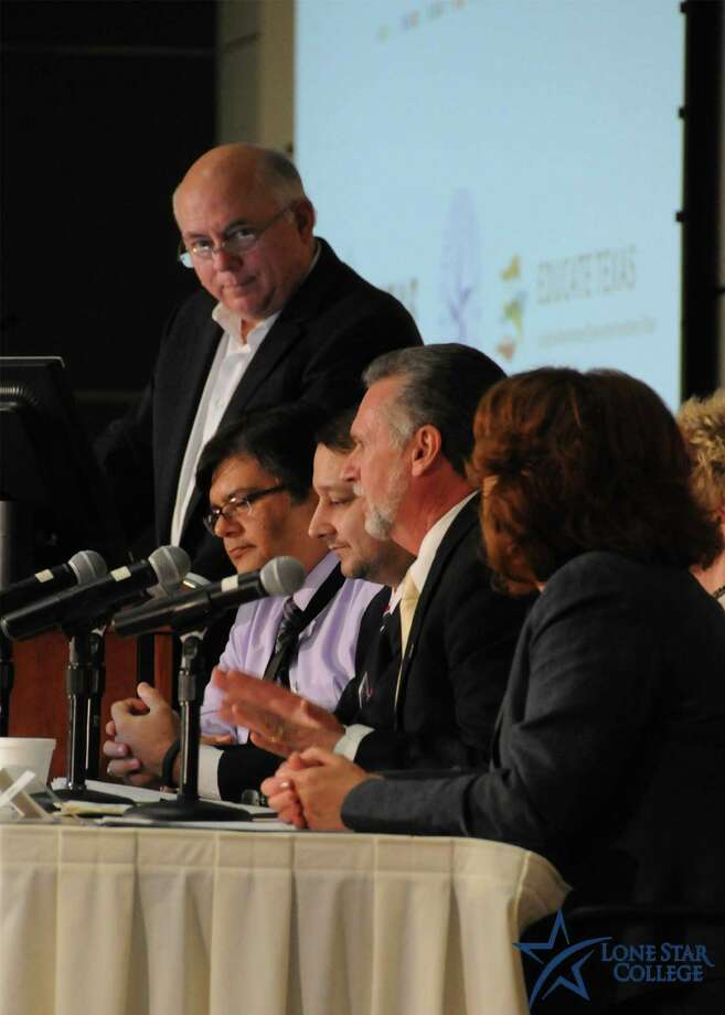 LSCS Chancellor Dr. Richard Carpenter moderates a panel discussion at the Texas Completion Summit. Photo: Photo Provided