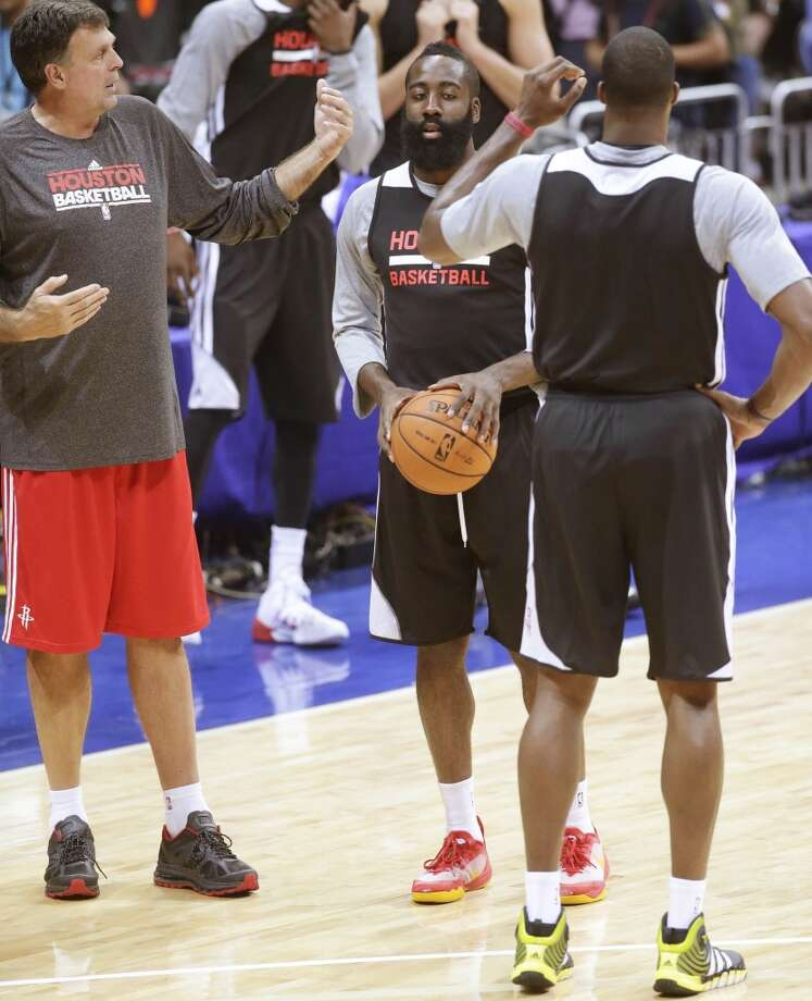 James Harden, center, listens to coach Kevin McHale, left, during their team practice on Tuesday. Photo: Bullit Marquez, Associated Press