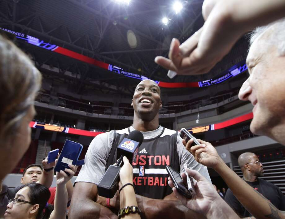 Dwight Howard shares a laugh with reporters on Tuesday. Photo: Bullit Marquez, Associated Press